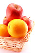 Oranges and apples in a basket