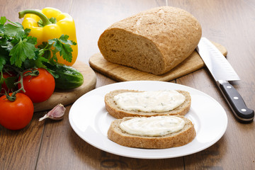 spread with cream cheese on bread