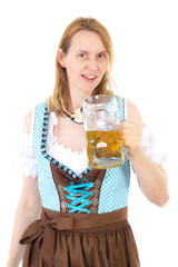 Blond woman with dirndl and beer at Oktoberfest