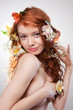 Portrait of beautiful naked woman with spring flowers