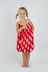 Girl in red polka dot dress