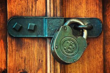 Bitcoins on padlock
