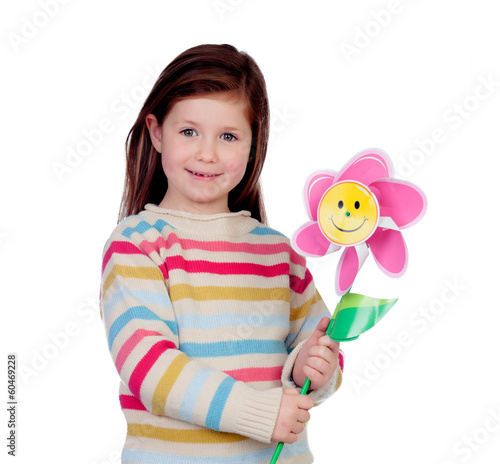 Beautiful little girl with a pinwheel