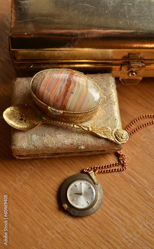 Old big golden box and vintage watch and teaspoon