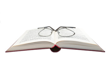 Glasses on opened book
