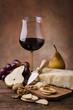 still life con formaggio parmigiano,vino e frutta
