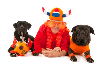 man with his dogs as Dutch soccer supporters