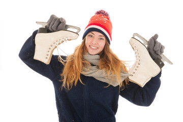 Attractive woman is having fun with ice skates