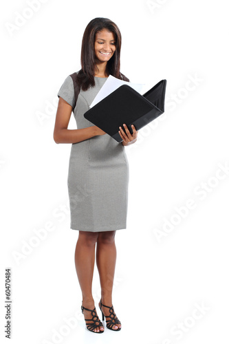 Standing african american businesswoman reading a report