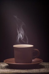 Cup of Coffee with Beautiful Steam on wood Background