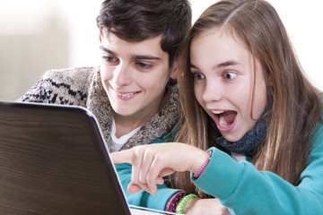happy young people with computer at home