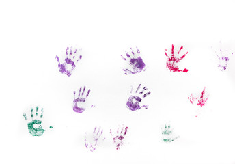 Children's hand prints on white wall