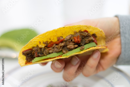 Close-up of hand holding a taco