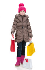 Pretty girl in winter clothes with shopping bags