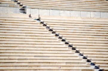 Rows of stone seats at stadium