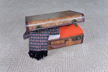 Ajar suitcase with clothes