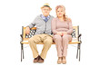 Lovely senior couple sitting on bench