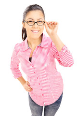 Smiling teenage girl in checkered shirt looking at camera