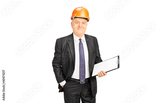 Mature construction worker holding clipboard