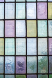 colored glass window with regular block pattern blue green tone