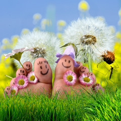 Happy together: Feet on  meadow with dandelions