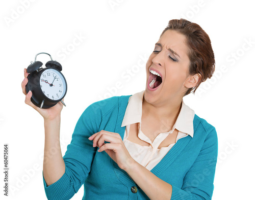 Sleepy woman with alarm clock