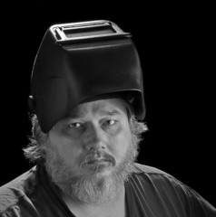 Man with welding helmet