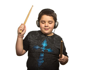 Boy with drumsticks