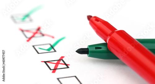 Leinwandbild Motiv Check list with two pens