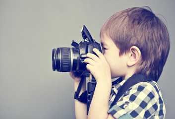Baby boy with camera