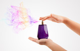 Fototapety woman hands spraying perfume
