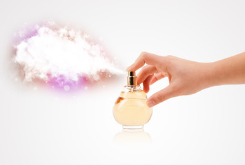woman hands spraying colorful cloud