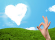 Leinwandbild Motiv Happy smiley fingers looking at heart shaped cloud