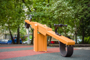 Seesaw swing on modern kids playground