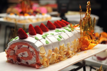 Swiss roll filled with cream and strawberries