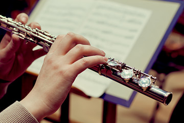 Hands of a woman playing a flute
