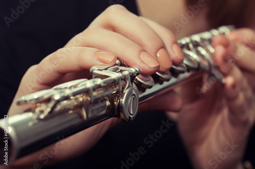 Hands girl playing a flute
