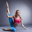 Beautiful flexible girl doing stretching exercises