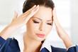 Businesswoman with a headache holding head
