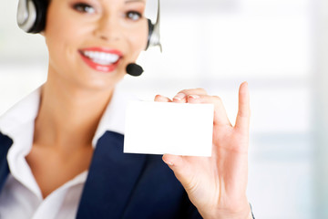 Customer service representative holding a blank card.