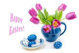 Easter decorations with tulips and painted eggs