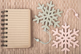Empty notebook and decorative snowflakes, space