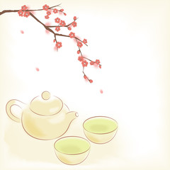 Traditional oriental teapot and cups with plum blossom