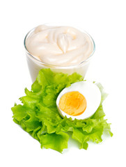 mayonnaise and boiled egg isolated on white