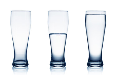 Isolated on white empty, half and full water glasses