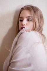 Beauty shy girl in wool cardigan