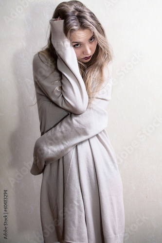 Beauty shy girl in wool cardigan