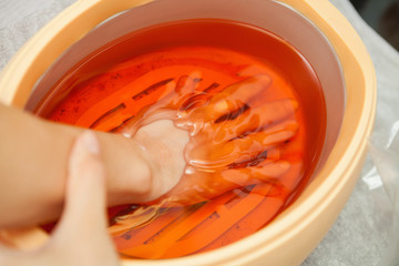 Spa salon. Manicure. Paraffin hand bath.