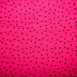 red textile background with black circles