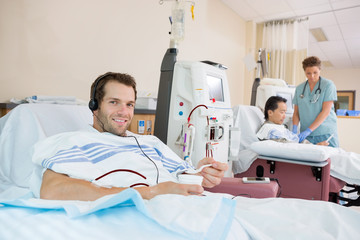 Patient Holding Glass Of Crushed Ice During Renal Dialysis